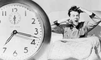 Man-Waking-Up-To-Alarm-Cl-007